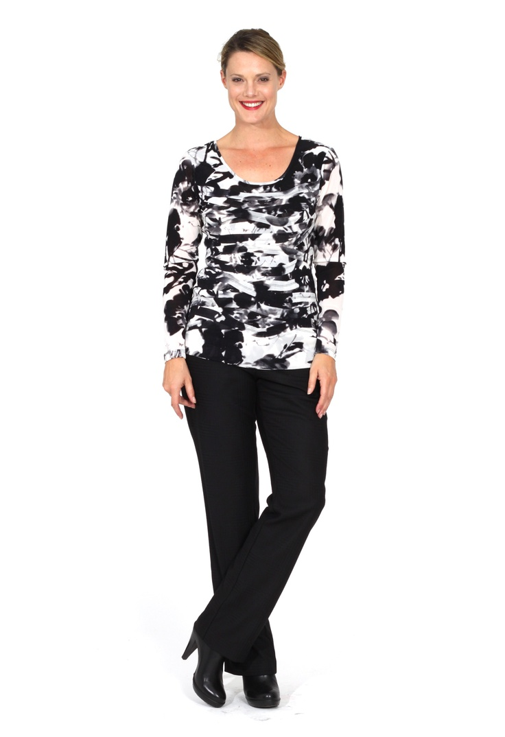 Redhead Office - Chelsea Top. The Black and White print design of this fabric works well in the top design the sits beautifully under any corporate suiting. The knit fabric is comfortable to wear and is opaque. The top looks great under a jacket or can be worn on its own.