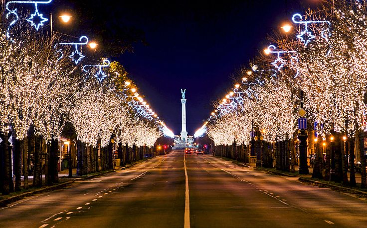 "The ""Avenue of lights"" leading all the way up arrow-stright Amdrássy Avenue to Heroes' Square in Budapest, Hungary #Budapest Winter Invitation"