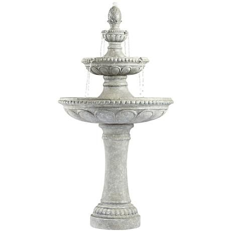 This decorative outdoor fountain in old stone finish is a transitional update of a classic three-tier bowl fountain.