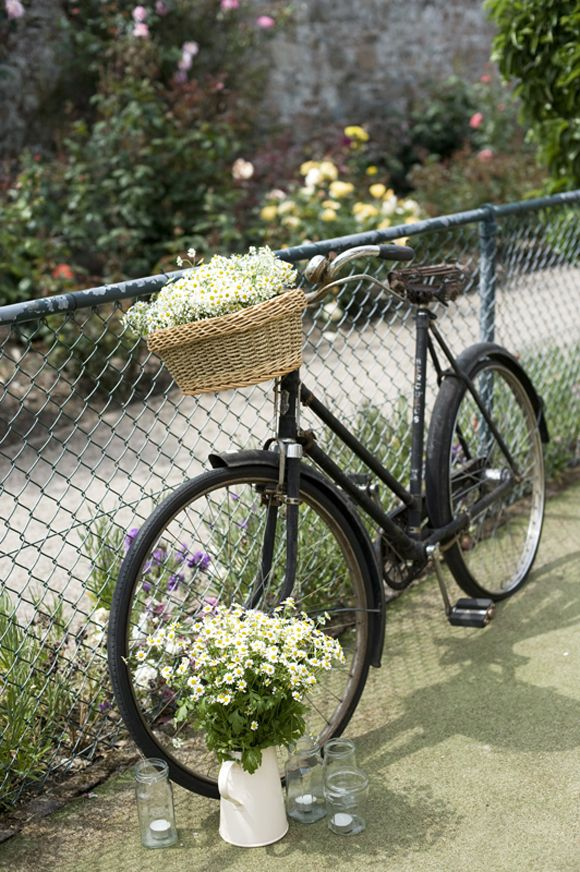 Love this bike and flowers arrangement for outside the church