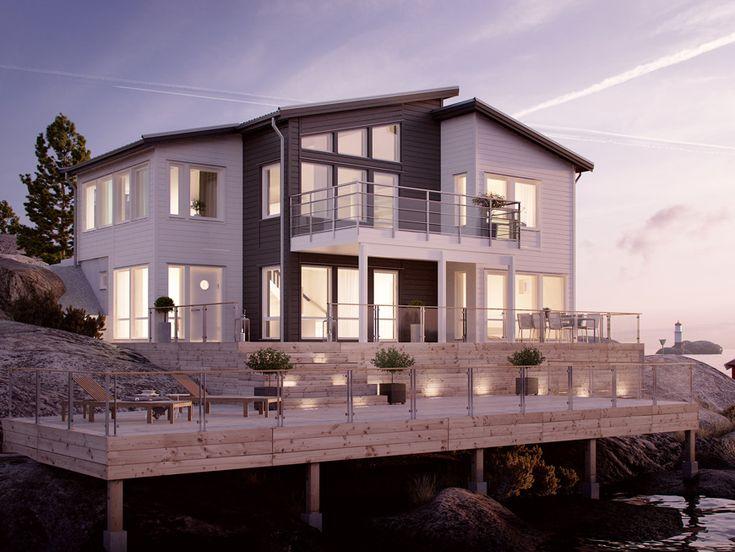Arholma är ett sluttningshus för den stora familjen. Huset har stora glaspartier.