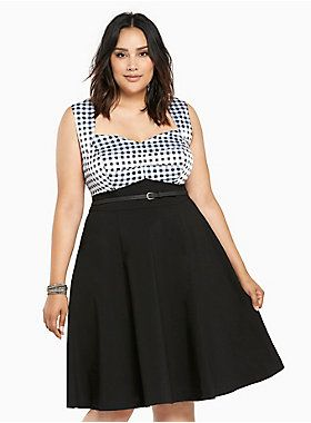 Perfect for twisting and shouting in with your steady, this swing dress is paying some major homage to rockabilly style. The fit and flare black skirt is a sleek contrast to the white and black gingham print silky bodice. Sweetheart neckline boosts your bust, an adjustable waist belt lends hourglass appeal (your boo will love both of those).