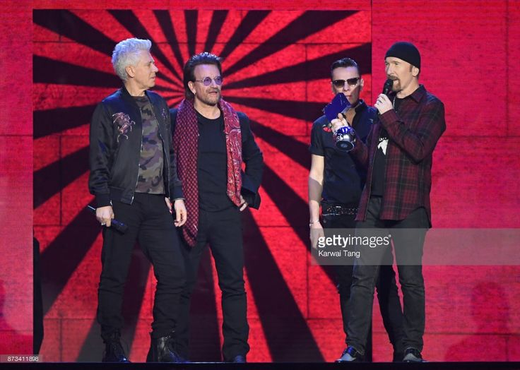 on Global Icon award winners Adam Clayton, Larry Mullen Jr, Bono and The Edge of U2 are seen on stage during the MTV EMAs 2017 held at The SSE Arena, Wembley on November 12, 2017 in London, England.