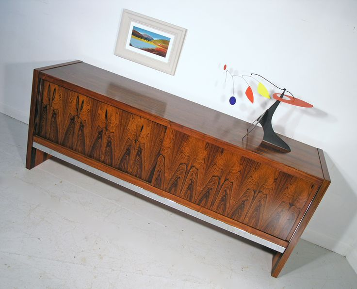 Merrow Associates rosewood sideboard with Manuel Marin sculpture and painting by Lindsey Hambleton. www.midcenturyhome.co.uk
