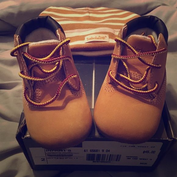 Baby Wheat Timberlands Gift Pack Baby size 2c wheat timbs. In excellent condition only worn a few times. Hat never worn. Comes with original box. Timberland Shoes Combat & Moto Boots