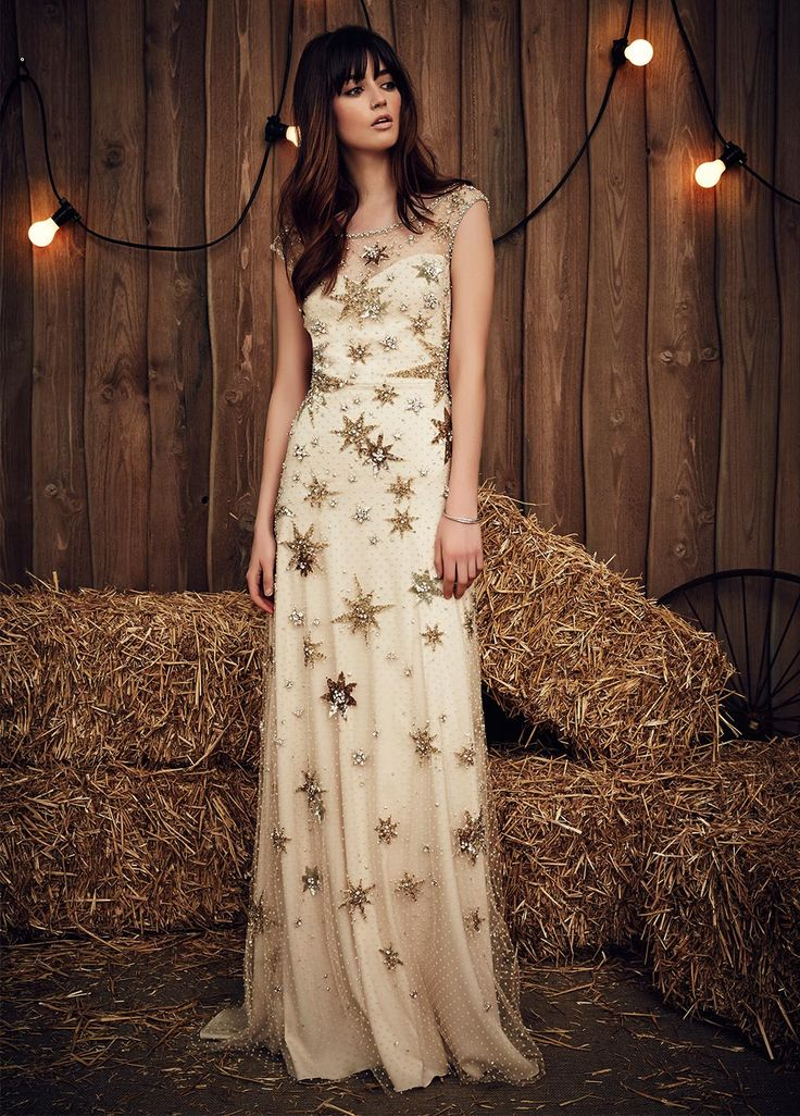 This star theme truly is out of this world and the colours are to die for. Neutral golds and browns are super flattering to any skin tone and the illusion neckline is a really feminine touch. This dress is completely adaptable to different wedding themes as the colours are warm and autumnal but the sparkle gives it that wintery touch.