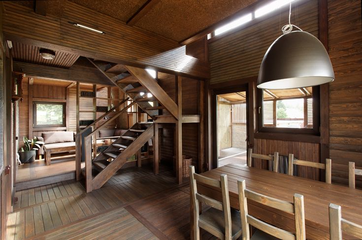 Wood Patchwork #House by Peter Kostelov | Like & pin it to your board if you like this! #architecture #residential #woodarchitecture #dining