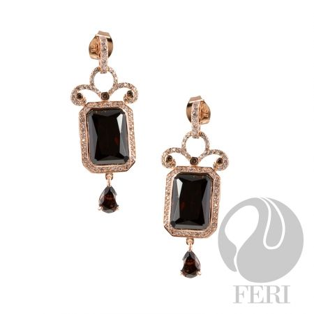 - Exclusive 950 fine sterling silver - Exclusive 3 micron rose gold plating - Set with AAA white cubic zirconia and a rich mahogany colored cubic zirconia