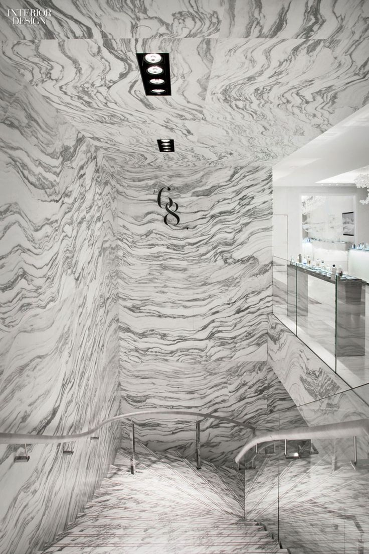 Italian Marble Meets Handrails Wrapped in Leather