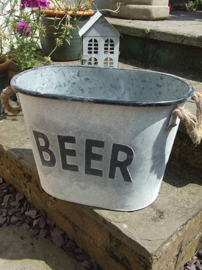 A fabulous zinc beer bucket.Absolutely lovely french vintage country living style beer/wine/bottle holder/ice bucket cooler. It has lovely traditional rope carrying handles. This item is perfect for al fresco dining. Antique zinc metal material with a gorgeous black 'beer' lettering on the front and black trim to the top. Ideal for a gift for this summer. It weighs approx 0.900KGS.metal.Measures 10inches tall by 14inches long by 8inches wide.