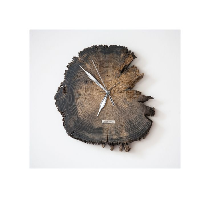 Model no 6. This clock is made of construction wood from the buildings of the Old Town of Gdansk. Black oak dating back to the 14th century. Size: 25 cm x 23 cm.