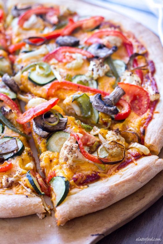 This easy pizza recipe is made with roasted vegetables and Sargento® Sharp Cheddar cheese to make a vegetarian comfort food! #sponsored