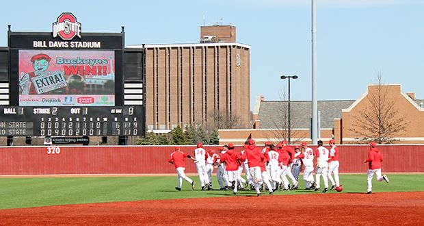 The OSU baseball team celebrates a walk-off win on April 5 at Bill Davis Stadium. OSU defeated Penn State, 7-6. Matt Wilkes / Lantern photographer