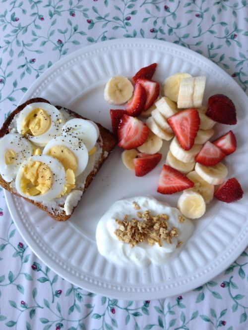 Breakfast: multigrain toast with one light laughing cow cheese and sliced hard boiled egg. Fruit salad, vanilla Greek yogurt and granola.