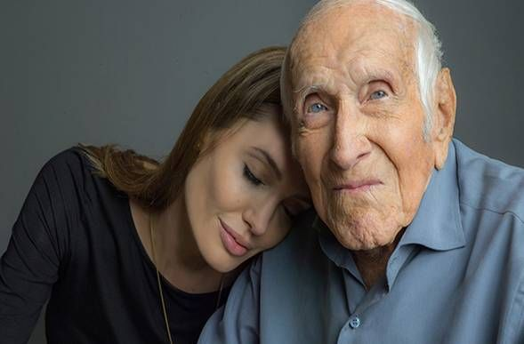 ANGELINA JOLIE DROPPED TO HER KNEES AND 'PRAYED FOR A MIRACLE' ON 'UNBROKEN' FILM SET AFTER TAKING INSPIRATION FROM CHRISTIAN HERO - Her miracle was answered with many witnesses watching.