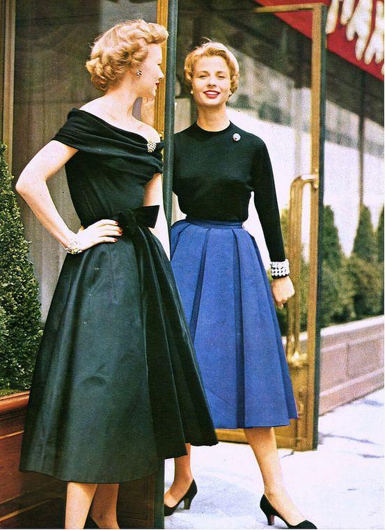 1954 Jacques Fath, Paris Vogue 50s cocktail dress black satin full skirt off shoulder portrait collar day wear office skirt sweater color photo print ad models magazine shoes hair knit blue wool