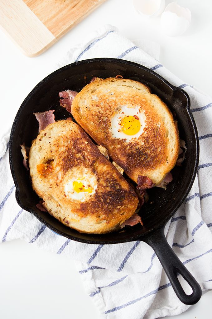 This recipe for Bacon Cheddar Grilled Cheese Egg in a Hole was so good that my boyfriend proposed to me - no joke!