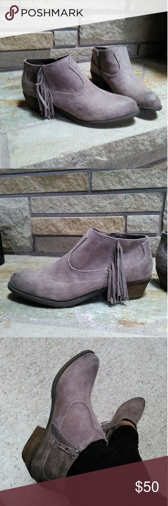 Carlos Santana taupe grey fringe ankle boots New Carlos by Carlos Santana Loretta grey taupe frunge ankle boots. Low heel oil rub distress with side fringe. Such a cute and cool bootie! New and unworn. Carlos Santana Shoes Ankle Boots & Booties