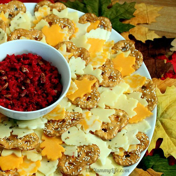 Easy Autumn Leaf Wreath Cheese Platter. Can be made 2-3- days ahead. An easy, festive way to serve cheese at a Fall party. Serve with fresh cranberry ginger pear relish. From TheYummyLife.com