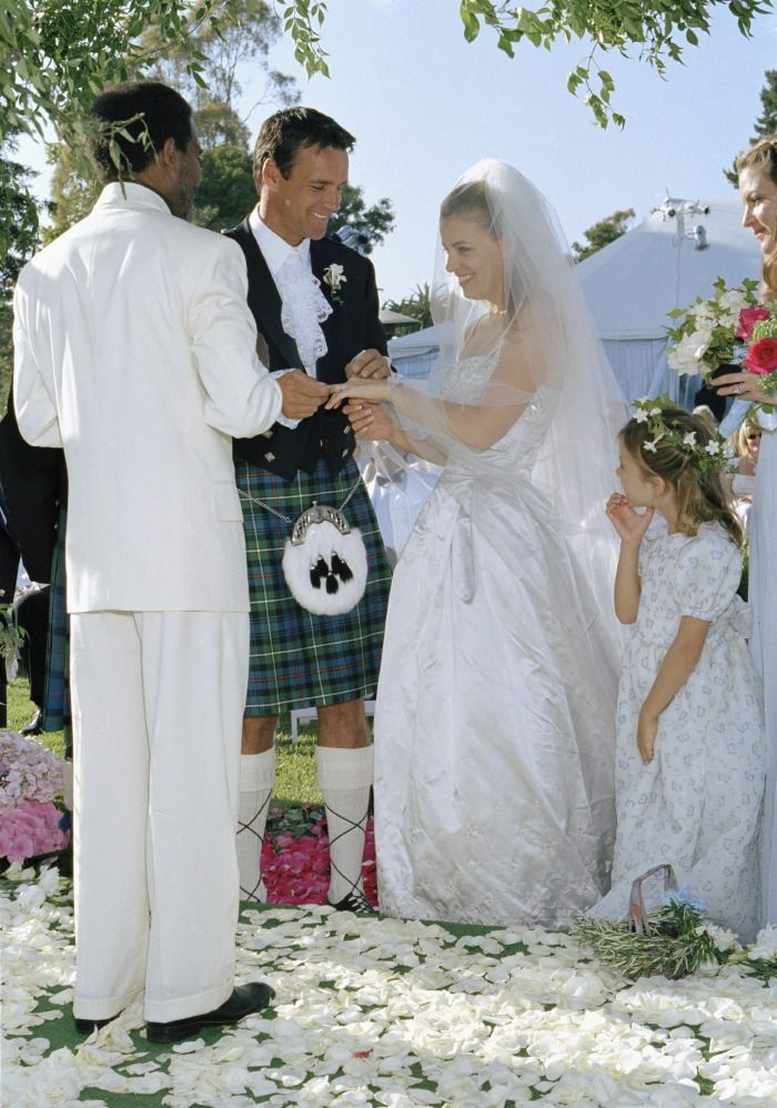 David James Elliott & Nanci Chambers first wed in 1992 in city hall when they didn't have much money, so they did it again in 1996 with daughter Stephanie as flower girl.