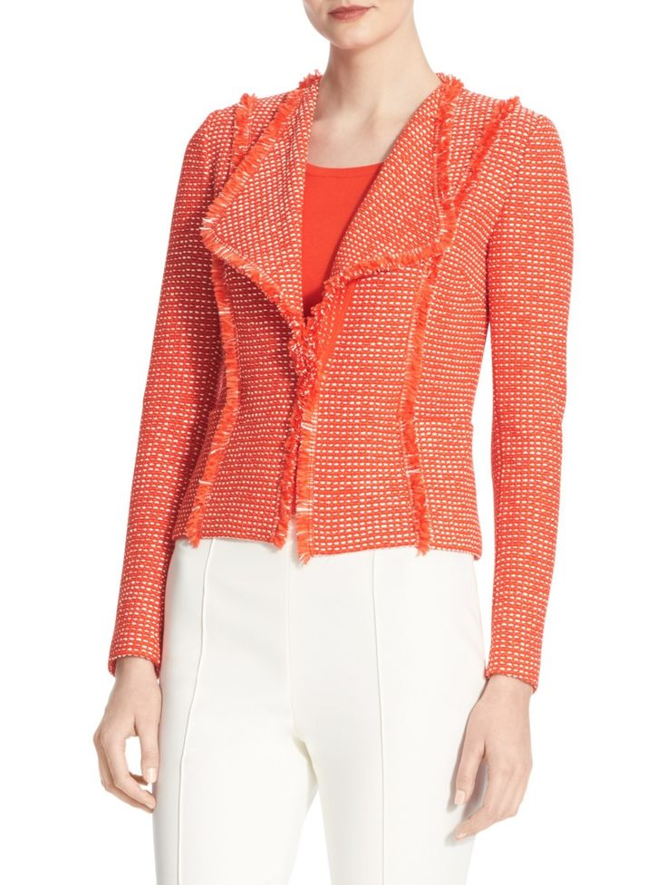 A dramatic collar and decorative fringe trim injects exotic allure into the Tajina knit jacket. A flattering favorite for all occasions. Pair with a Milano sheath or Emma pant.