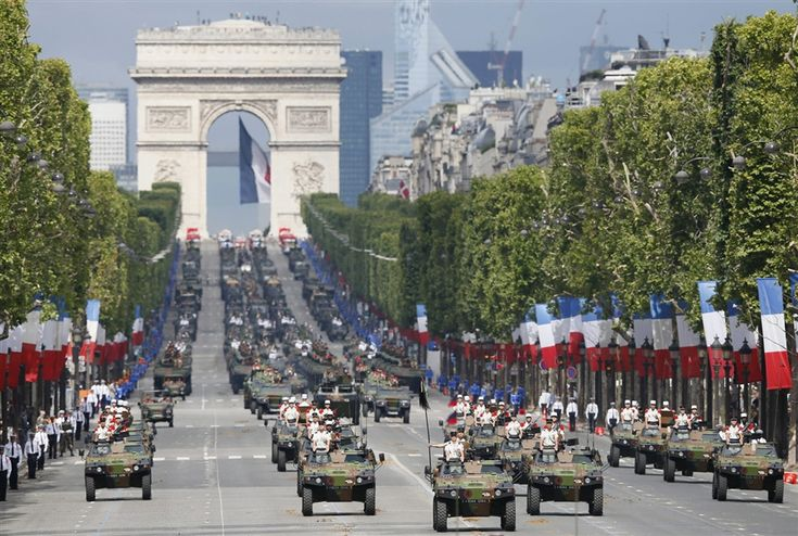 Armored vehicles parade down the Champs Elysees as part of the Bastille Day Military parade in Paris, France, on July 14. The Bastille Day, the French National Day, is held annually on July 14 to commemorate the storming of the Bastille fortress in 1789.
