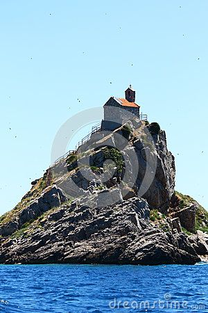 Small church situated on a tall rocky island from the Adriatic sea in Montenegro.
