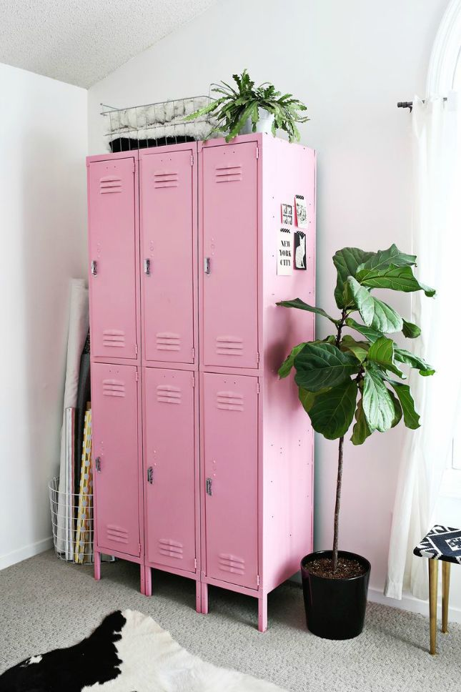 "These upcycled lockers settled nicely into this ""art room"" after a coat of pink paint."