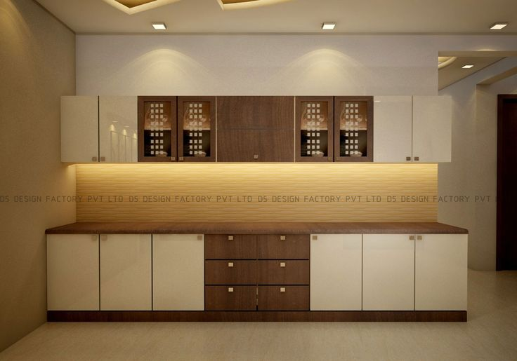 The kitchen is in mahogany and white finish. There is a blackboard for noting the menu and recipes and a love seat under an array of interesting wall decor.