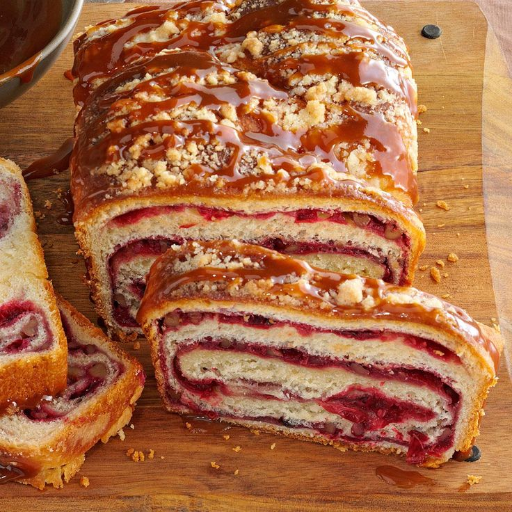 Cranberry Swirl Loaf Recipe -My mother's made this bread for years, but she uses date filling. I loved her bread so much that I made my own with cranberries for a slightly tart filling with the sweet streusel topping. Each slice reveals an enticing ruby swirl. —Darlene Brenden, Salem, Oregon