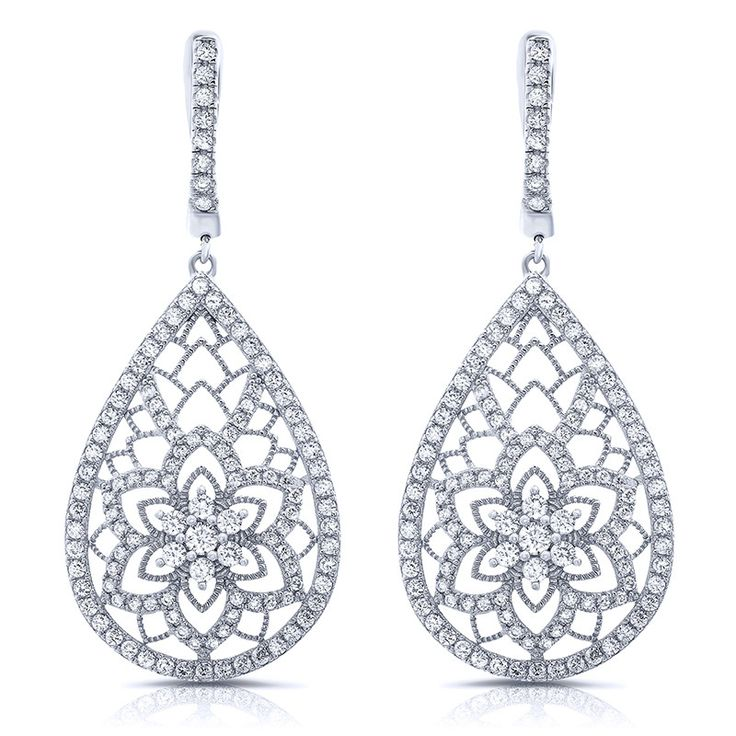 Sterling silver floral shape drop earrings and simulated diamonds by swarovski. ZE-0261 925 SOLID STERLING SILVER. SIGNATY simulated diamonds by Swarovski TRIPLE rhodium plated bonded with 1% platinum