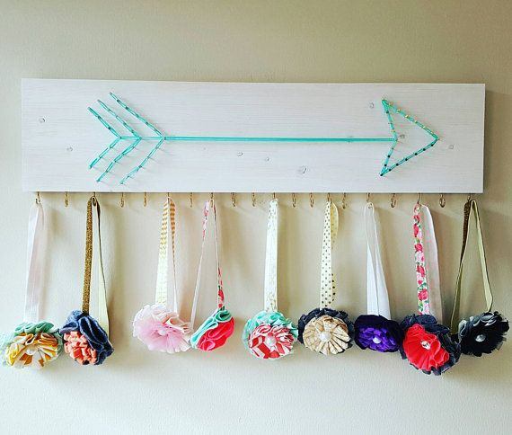 Bohemian baby headband holder. Cute and useful organizer idea for a boho nursery or little girl's room!