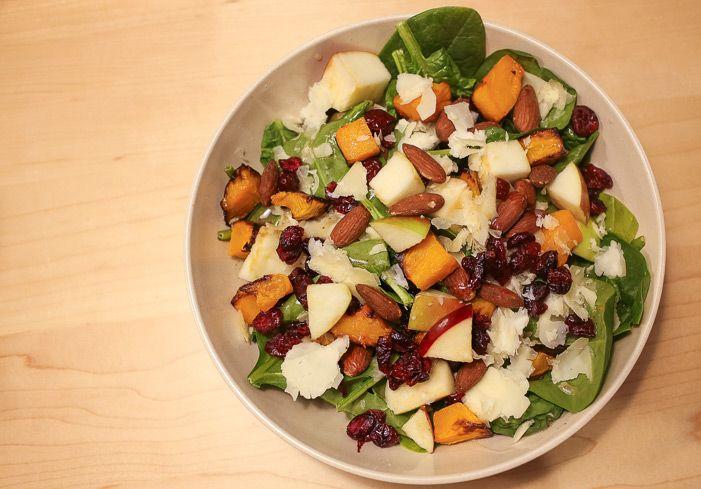 b.good's Roasted Butternut Salad - baby spinach, butternut squash, sharp cheddar, apples, tamari almonds, dried cranberries, and maple-mustard vinaigrette