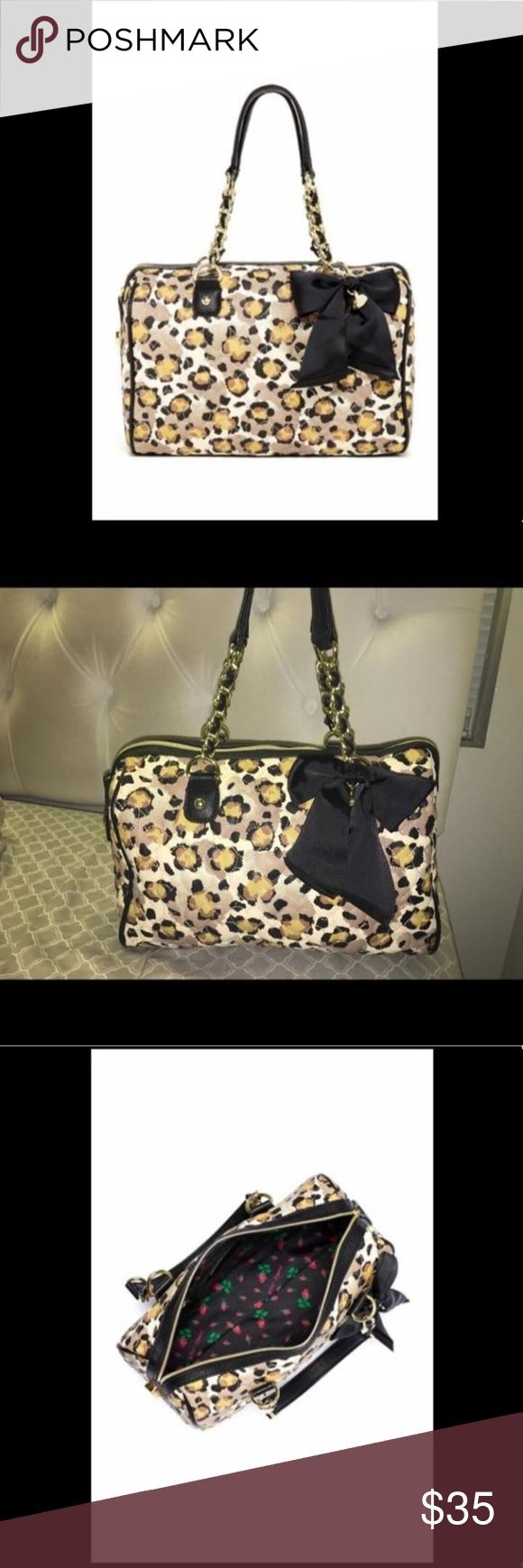 """Betsey Johnson Be My Sweetheart Satchel Betsy Johnson - The Be My Sweetheart Satchel in leopard print. It's a very flexible bag, can fit many things inside. Only used twice Originally $65!!! Shipping included in price.  Details: - Dual top chain accented handles - Zip top closure - Interior features zip wall pocket and 2 media pockets - Approx. 11"""" H x 13"""" W x 5"""" D - Approx. 5"""" handle drop  Materials: PU exterior, fabric lining Care Wipe with dry cloth Betsey Johnson Bags Satchels"""