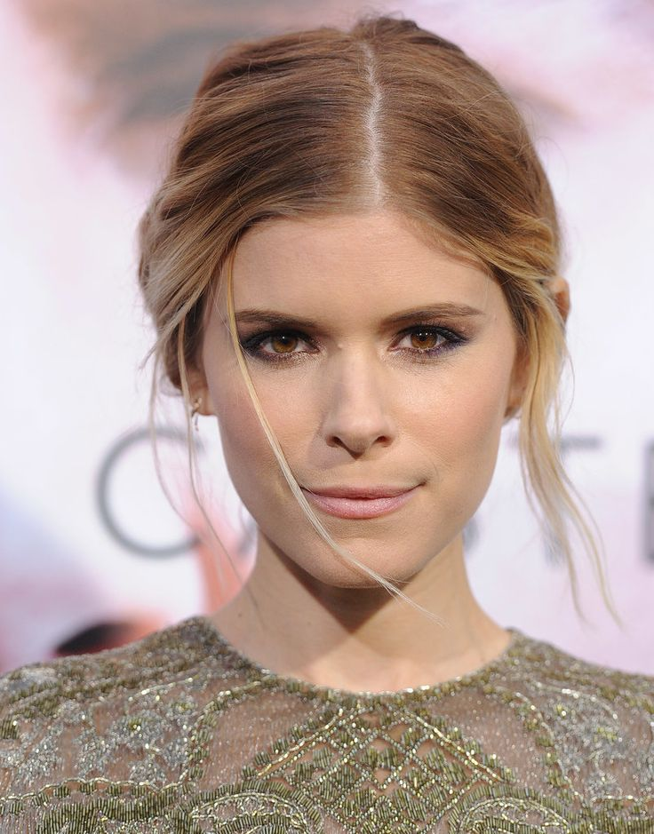 Honestly, Kate Mara sort of snuck up on us. Just a few years ago, she was Rooney Mara's little sister, but now she's broken out as a beauty star of her own. Kate's best beauty looks are kind of sneaky, too. Every time she hits the red carpet, the actress wows the crowd with her sleek updos, but then she turns around and BAM! All her hairstyles are glamorous in the front and party in the back. #prom