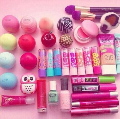 Lip balm collection with: EOS lip balms, Sephora lip balms, H&M owl lip balm, BABY LIPS sticks, macaroon lip balm and lip gloss tubes.
