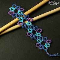 Cro-tat: lots of ideas on this site.  I'm not as good at tatting as I am at crochet, but I think I can tell how some of these are constructed.  Very cute!