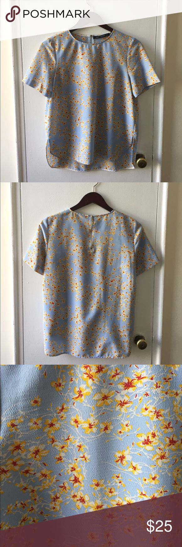 Zara Silky Floral Tee Tshirt style blouse with blue/yellow/red floral pattern. Short silver zip up back. EUC. Size M. Zara Tops Blouses