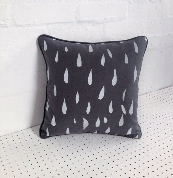 The Ray. Hand printed cushion cover in grey 100% linen, screen printed by hand with silver and white teardrop design. Made in London.