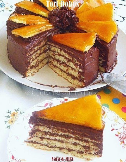 Blaturi subtiri, crema densa de ciocolata si caramel, toate in proportii bine stabilite dupa o reteta stricta, definesc o prajitura celebra –Tortul Dobos, una din retetele de referint…