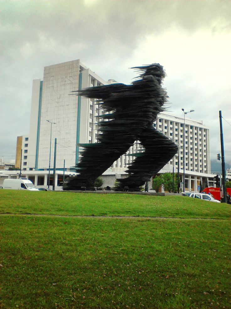 Dromeas sculpture (Runner) by Costas Varotsos in front of Athens Hilton. (Walking Athens, Route 12 - Concert Hall)