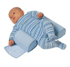 Baby Sleeping Wedge for Crib... Good for a newborn if you're afraid of choking when they sleep. Once they start to move around the crib I recommend no more use.