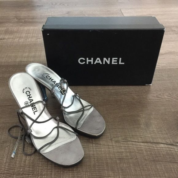Sale❗️⬇️CHANEL Authentic Silver Wrap Heel Sandals These are 100% authentic metallic silver tone leather Chanel strappy ankle wrap sandals with embroidered logo at covered heels and buckle closure at chain straps. In excellent condition. Comes with original box. A little wear on the straps. Heel height: 3.5 inches. The vibram soles were added for additional support at the base. For reference, a similar style can be seen on Chanel Iman. Size: 38 but will also fit a 7.5. 🚫 trades. Price is…