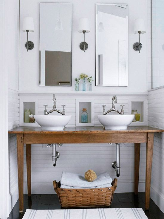 Refinish an antique table to serve as a sturdy but stylish bathroom vanity. Classic vessel sinks and bridge faucets complete this clean and simple cottage look.