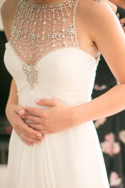 beautiful wedding dress white with crystal chains on chest. Gorgeous bridal gown