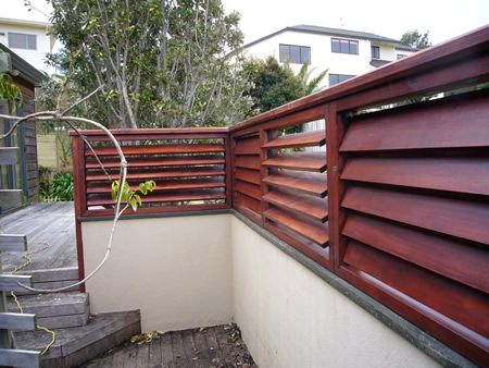 DIY Fences , Concrete blocks for the base, covered with hypertufa , brick or rock facing then build the top part with slats using composite roof decking for a longer lasting fence.
