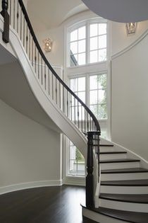 Winnetka SunFilled Dramatic Curved Staircase with 30' Window Backdrop Staircase Architectural Detail Architectural Details Modern Transitional by Reynolds Architecture, Design & Construction