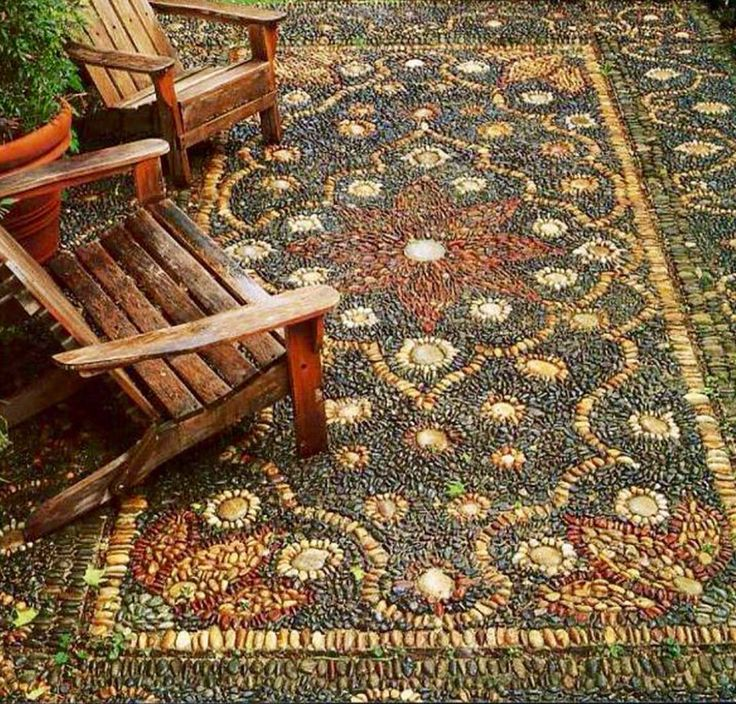 Outdoor Rug Made Of Multi Color Rocks Garden And Plants