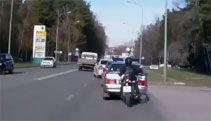 Video: Biker Crashes Into Police Car