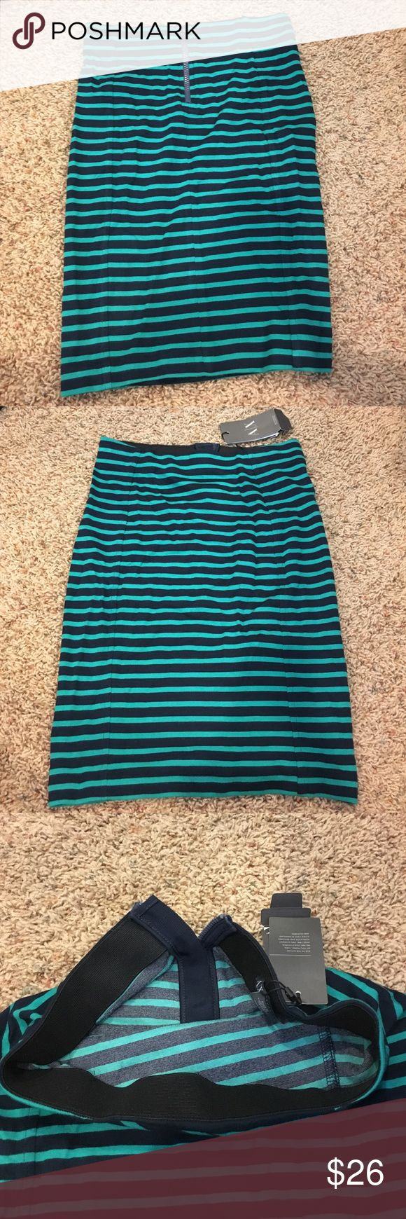 Stripped dark green and black xxs skirt I'm a size 0-2 for skirts this is a brand new skirt xxs Armani exchange pencil skirt. Elastic band waist and zipper back. A/X Armani Exchange Skirts Pencil
